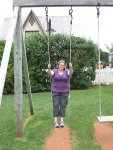 On the swing by the school