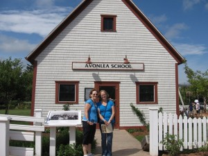 Mom and Hannah in front of the Avonlea one-room school house, which was once an actual school