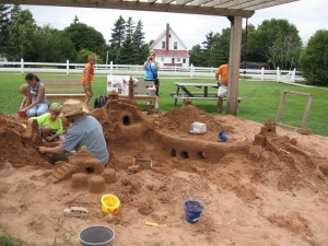 Behind the school was an artist creating an AMAZING sandcastle